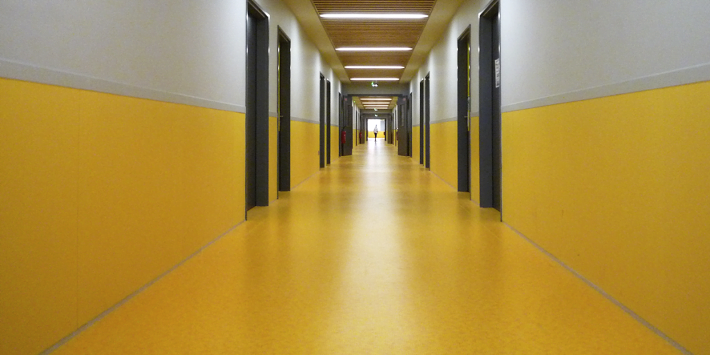 yellow coloured wall protector in hallway